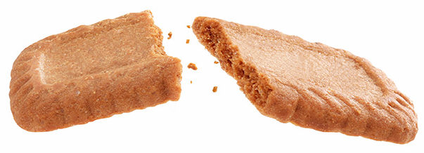 broken caramel biscuits fly isolated on white background