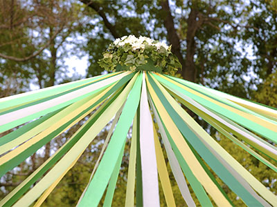 The top or upper half of a May pole used in celebration of May Day.