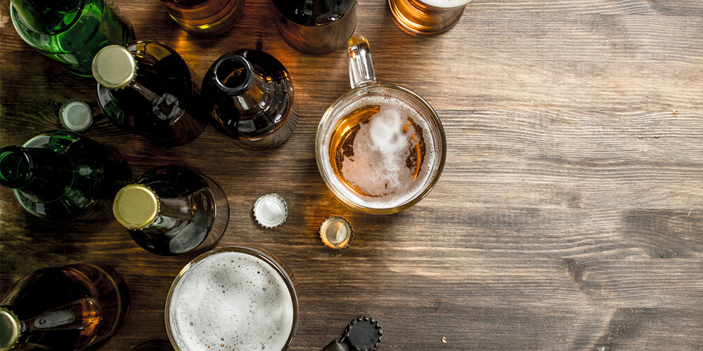 Beer background. Fresh beer on wooden table.